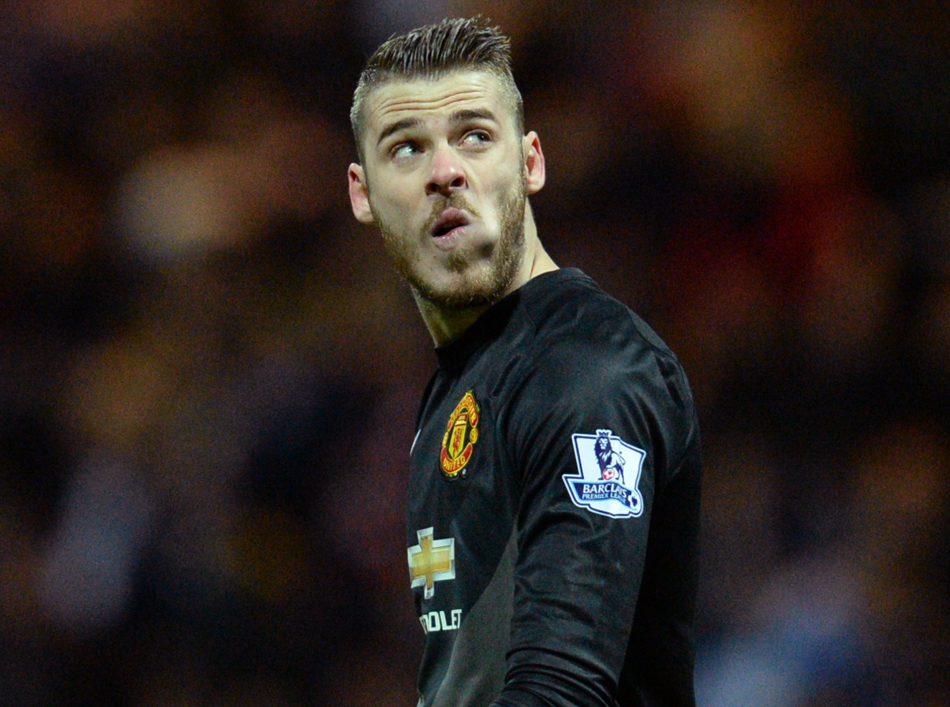 Manchester United's Spanish goalkeeper David de Gea looks at the replay screen during the FA Cup fifth round football match between Preston North End and Manchester United at Deepdale Stadium in Preston, north west England, on February 16, 2015. AFP PHOTO / OLI SCARFF  == RESTRICTED TO EDITORIAL USE. No use with unauthorized audio, video, data, fixture lists, club/league logos or live services. Online in-match use limited to 45 images, no video emulation. No use in betting, games or single club/league/player publications.  ==        (Photo credit should read OLI SCARFF/AFP/Getty Images)