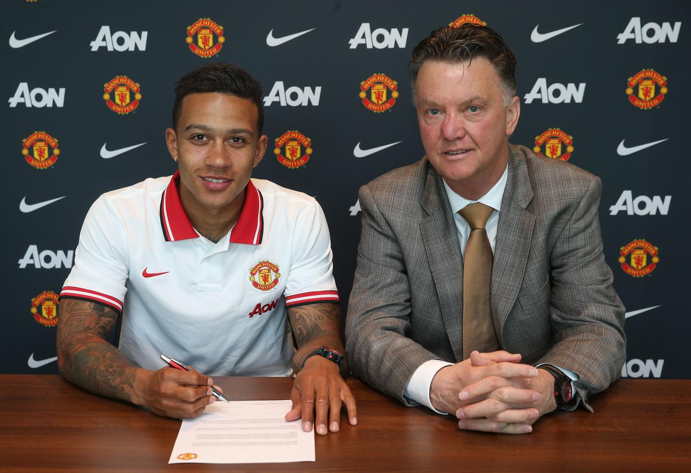 Manchester United Unveil New Signing Memphis Depay John Peters/Man Utd via Getty Images