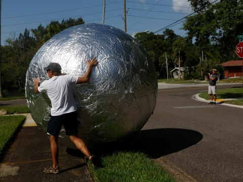 This man's neighbours hated his tin foil house – so he rolled it up into a giant ball