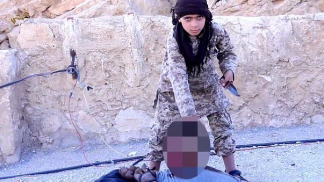 The young boy can be seen holding the soldier by the neck shortly before executing him