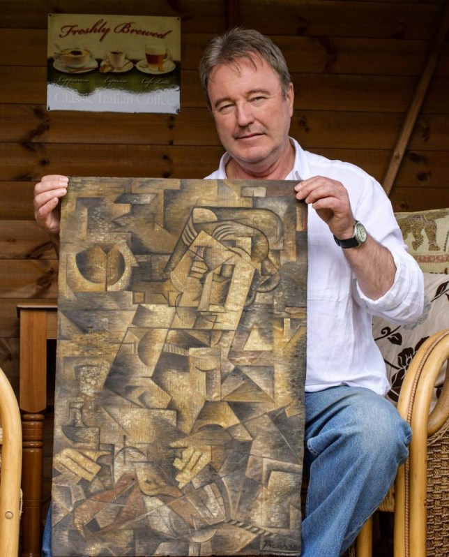 Dominic Currie with the painting he claimed to have found in his dead mother's suitcase - he tried to  pass of the Cubist canvas as a Pablo Piccaso original. See Centre Press story CPPICASSO: A man whose discovery of a possible Picasso painting in his attic admitted the story was all a hoax. Dominic Currie, 58, claimed he opened a suitcase and was astonished to find what could be a long-lost masterpiece. But research undertaken by Bendor Grosvenor - an art specialist in Edinburgh - has uncovered that, under the fraudsterís wifeís eBay account, Russian memorabilia was bought over the past six months.