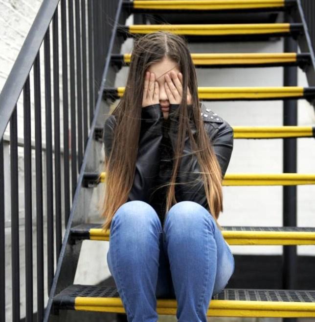 Depressed teenager on steps