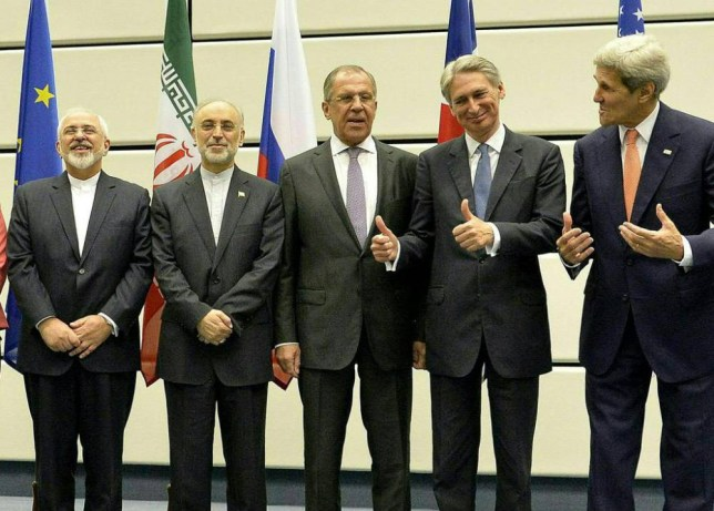 epaselect epa04846012 Both US Secretary of State John Kerry (extreme right) and British Foreign Secretary Philip Hammond (second from right) gesture towards Iranian Foreign Minister Mohammad Javad Zarif (extreme left) during a press conference following the conclusion of the E3+3 and Iran nuclear reduction talks, in Vienna 14 July 2015. Also in attendance is Iran's Ambassador to the IAEA Ali Akbar Salehi (second from left) and Russian Foreign Minister Sergei Lavrov (third from left)  EPA/HERBERT NEUBAUER