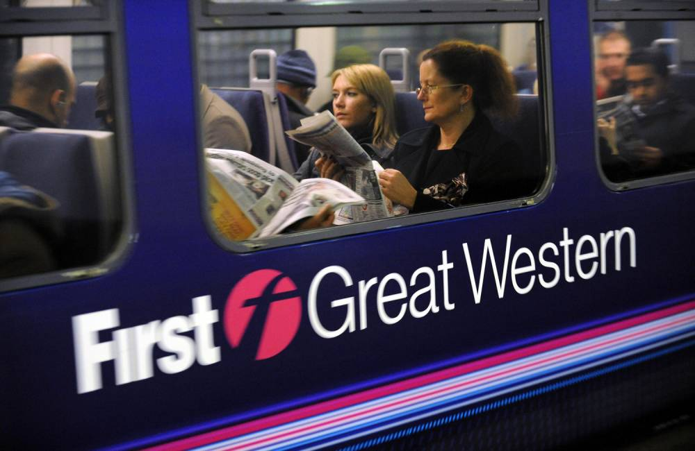 A First Great Western train departs Paddington Station during delays and cancellations of its services to the west this evening due to flooding at Swindon, through which many of the trains pass.