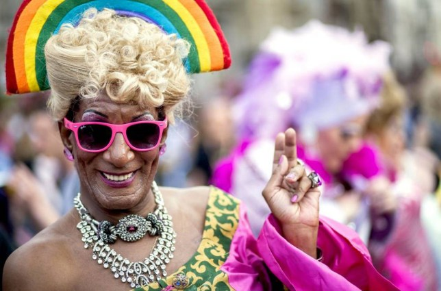 Mandatory Credit: Photo by NurPhoto/REX Shutterstock (4885255f).. People take part in the annual Pride in London Parade.. Pride in London parade, Britain - 27 Jun 2015.. Pride in London is one of the world's biggest LGBT+ celebrations as thousands of people take part in a parade and attend performances at various locations across the city...