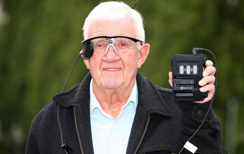 """EMBARGOED TO 0001 WEDNESDAY JULY 22 Partially sighted pensioner Raymond Flynn, 80, from Audenshaw, Manchester, speaks during a press conference at the Manchester Royal Infirmary, after he had his central vision restored for the first time in nearly a decade after he received a """"bionic eye"""", and is the world's first patient with advanced dry Age Related Macular Degeneration (AMD) to undergo the procedure. PRESS ASSOCIATION Photo. Picture date: Tuesday July 21, 2015. The retired engineer, who has peripheral vision, is also believed to be the first human being to have the use of combined natural and artificial sight. The Argus II retinal implant that he received last month at Manchester Royal Eye Hospital in a four-hour procedure has already been successfully used worldwide on more than 130 patients with the rare eye disease Retinitis Pigmentosa (RP). However those patients, unlike Mr Flynn, had no peripheral vision. See PA story HEALTH Eye. Photo credit should read: Peter Byrne/PA Wire"""