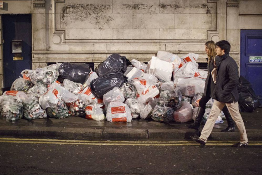 Mandatory Credit: Photo by News Pictures/REX Shutterstock (3429558x).. A pile of bin bags full of empty cans and bottles.. 'Mad Friday' casualties of Christmas celebrations and drinking in Soho, London, Britain - 14 Dec 2013.. 'Mad Friday' is one of the last Friday nights out before Christmas and also the busiest night of the year for emergency services coping with people who have drunk too much or have been injured as a result of inebriation...