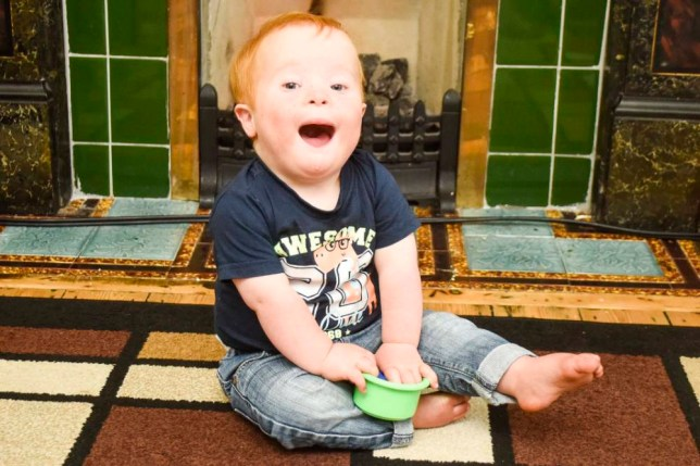 PIC BY DAN ROWLANDS/MERCURY PRESS (PICTURED: JACK CLAYTON PLAYING) A toddler with Downís Syndrome and a ëHollywood smileí has become a social media star with thousands of followers ñ despite doctors advising his parents to abort him. Little Jack Clayton, who is 20 months old, has his own Twitter and Facebook pages documenting his family life and cheeky mishaps, with a 12,000-strong following from all over the world. His antics ñ posted along with witty captions from stay-at-home dad Lawrence Clayton ñ have captured the hearts of people as far afield as Canada and New Zealand. Lawrence and Jackís mum Nici Allen, 42, who both refused genetic testing to determine whether their son would be born disabled, believe Jack ëbridges the gapí between those living with and without a disability. SEE MERCURY COPY