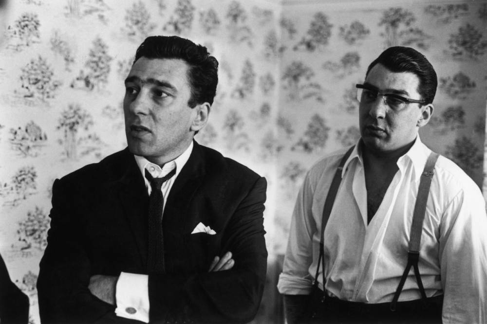 London gangsters the Kray twins, Reggie (1933 - 2000, left) and Ronnie (1933 - 1995) after spending 36 hours helping the police with their inquiry into the murder of George Cornell, 6th August 1966. They were found guilty of murder in 1969 after a trial at the Old Bailey. (Photo by William Lovelace/Daily Express/Hulton Archive/Getty Images)