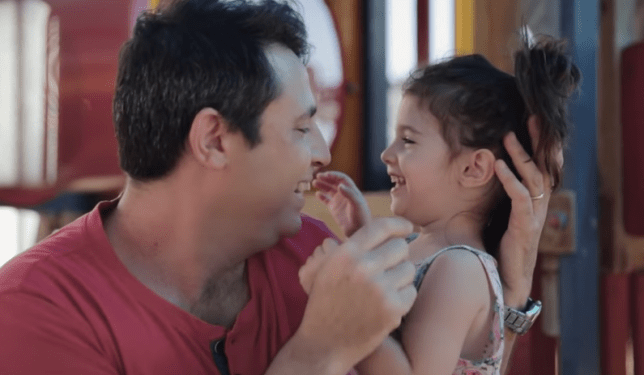 father holds daughter in advert for razors