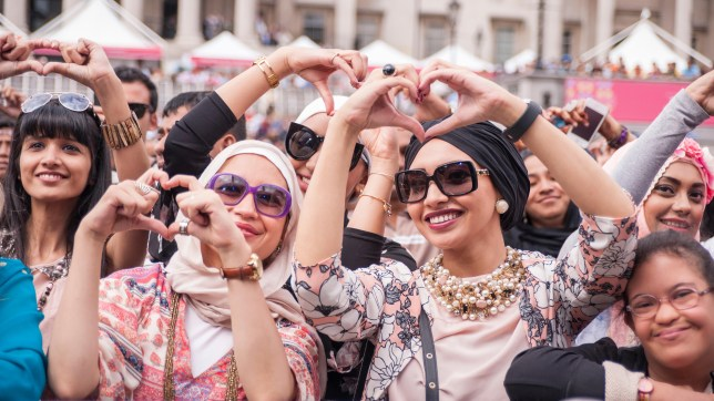 Thousands headed to Trafalgar Square for the annual Eid Festival, organised by the Mayor of London, in celebration of the end of Ramadan.    Pictured: people in the audience enjoy the stage entertainment.    © Stephen Chung/Alamy Live News