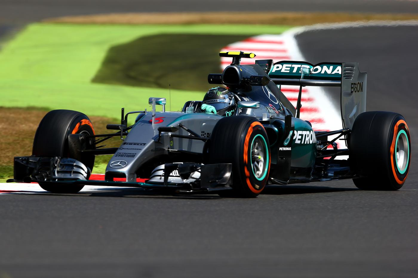 Nico Rosberg leaves Lewis Hamilton trailing in his wake during first practice at British Grand Prix