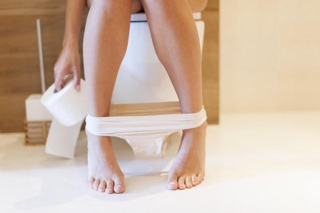 Part of woman on toilet gpointstudio/gpointstudio