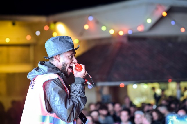 Mos Def performs on stage during the first live music event at Banksy's Dismaland, Tropicana in Western-super-Mare, Somerset. PRESS ASSOCIATION Photo. Picture date: Friday August 28, 2015. Photo credit should read: Ben Birchall/PA Wire