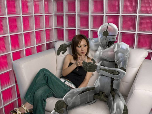 Woman and robot sitting together