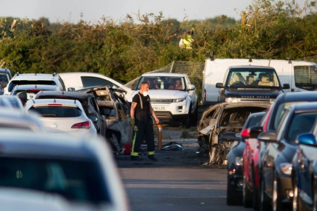 File photo dated 31/07/15 of emergency services at the scene of a plane crash at Blackbushe Airport in Hampshire, as three members of the bin Laden family were killed after their plane avoided a microlight and then landed too far down the runway, air accident investigators have found. PRESS ASSOCIATION Photo. Issue date: Tuesday August 4, 2015. Relatives of al Qaida founder Osama bin Laden were among the four people, including the pilot, who died when a private jet crash-landed at a car auction site in Hampshire. See PA story ACCIDENT Aircraft. Photo credit should read: Daniel Leal-Olivas/PA Wire