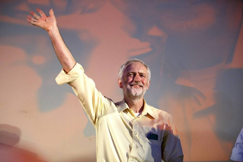 LONDON, UNITED KINGDOM - AUGUST 03: Labour Party leader candidate Jeremy Corbyn greets his supporters during a rally at Camden Centre in London, England on August 3, 2015. (Photo by Tolga Akmen/Anadolu Agency/Getty Images)