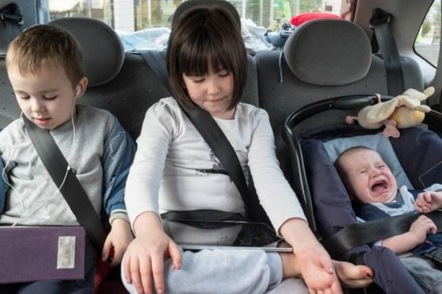 3 siblings in car,2 with tablets,1 kid screaming!