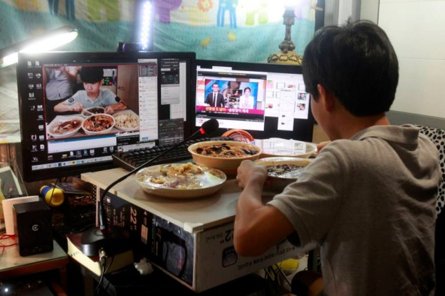 In this Monday, Aug. 17, 2015 photo, Kim Sung-jin, 14, broadcasts himself eating delivery Chinese food in his room at home in Bucheon, south of Seoul, South Korea. Every evening, he gorges on food as he chats before a live camera with hundreds, sometimes thousands, of teenagers watching. Thatís the show, and it makes Kim money: 2 million won ($1,700) in his most successful episode. Better known to his viewers by the nickname Patoo, he is one of the youngest broadcasters on Afreeca TV, an app for live-broadcasting video online launched in 2006. (AP Photo/Julie Yoon)