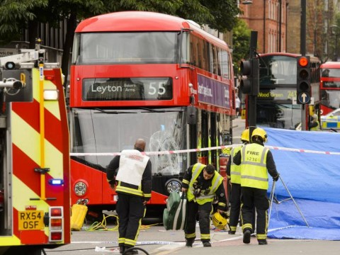 Londoners attempt to prise Routemaster bus off man trapped underneath