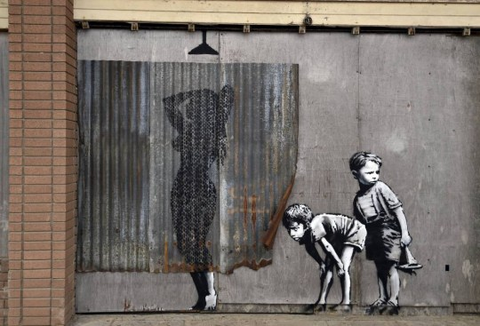 A mural is pictured at 'Dismaland', a theme park-styled art installation by British artist Banksy, at Weston-Super-Mare in southwest England, Britain, August 20, 2015. REUTERS/Toby Melville
