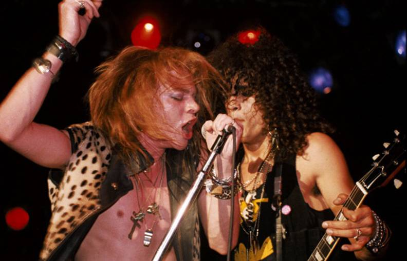 LOS ANGELES - JANUARY 4: (L-R) Axl Rose and Slash of the rock band 'Guns n' Roses' perform onstage at the Troubadour where they played 'My Michelle' for the first time on January 4, 1986 in Los Angeles, California. (Photo by Marc S Canter/Michael Ochs Archives/Getty Images)