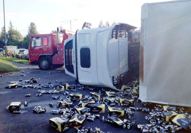 "A lorry carrying cider overturned at a roundabout near Worcester spilling its load all over the carriageway. See NTI story NTICIDER. The 38-tonne lorry was ""fully loaded with Strongbow cider"" when it overturned at the A44/A4103 roundabout at around 5.50pm on Wednesday 27 August, 2015. The driver was unhurt. Six police cars and a towing vehicle were at the scene and hundreds of cider cans were strewn across the road. Drivers were asked to avoid the route if possible due to a ""large spillage"". The road reopened around 9pm."