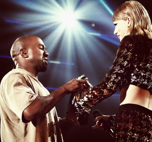 LOS ANGELES, CA - AUGUST 30: (EDITORS NOTE: This image has been altered using digital filters.) Recording artist Kanye West (L) accepts the Vanguard Award from recording artist Taylor Swift onstage during the 2015 MTV Video Music Awards at Microsoft Theater on August 30, 2015 in Los Angeles, California. (Photo by Christopher Polk/MTV1415/Getty Images)