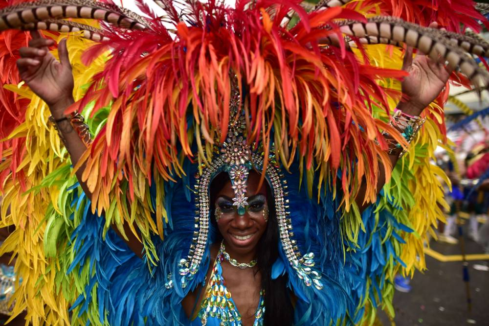 A performer poses for a photograph on the second day of the Notting Hill Carnival in west London on August 31, 2015. Nearly one million people are expected by the organizers Sunday and Monday in the streets of west London's Notting Hill to celebrate Caribbean culture at a carnival considered the largest street demonstration in Europe. The Notting Hill Carnival started in the 1960s, when the area had a large population of immigrants recently arrived from the Caribbean and was notorious for its slums -- a far cry from today when it is one of London's most expensive places to live. AFP PHOTO / LEON NEALLEON NEAL/AFP/Getty Images