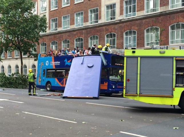 London tour bus roof ripped off after crashing into a tree (Picture: @Chromrisan/Twitter)