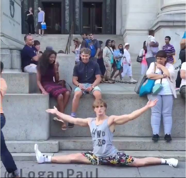 Logan Paul randomly drops into the splits all over New York. Because lols.