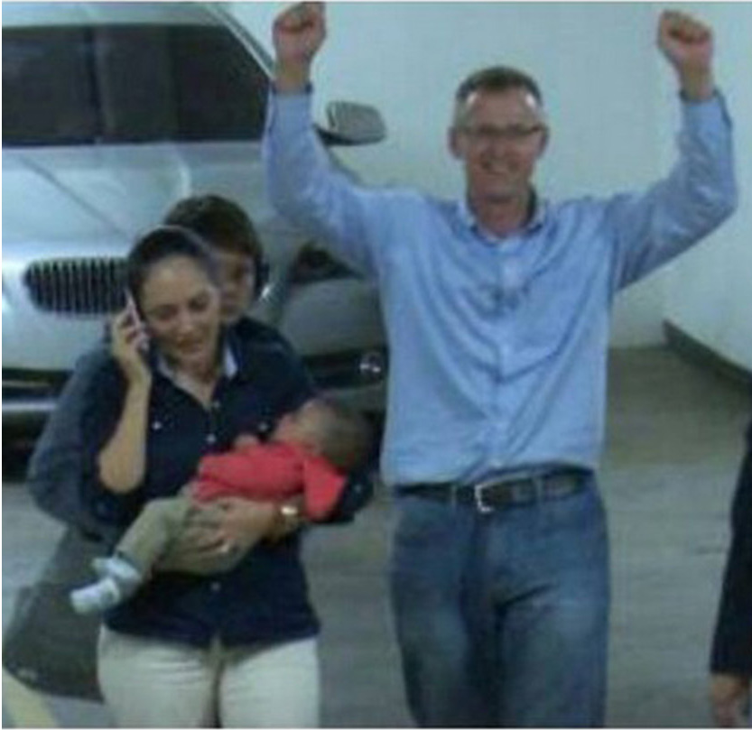 Richard Cushworth and wife Mercedes Casanellas prepare to hand their non-biological child back to its mother