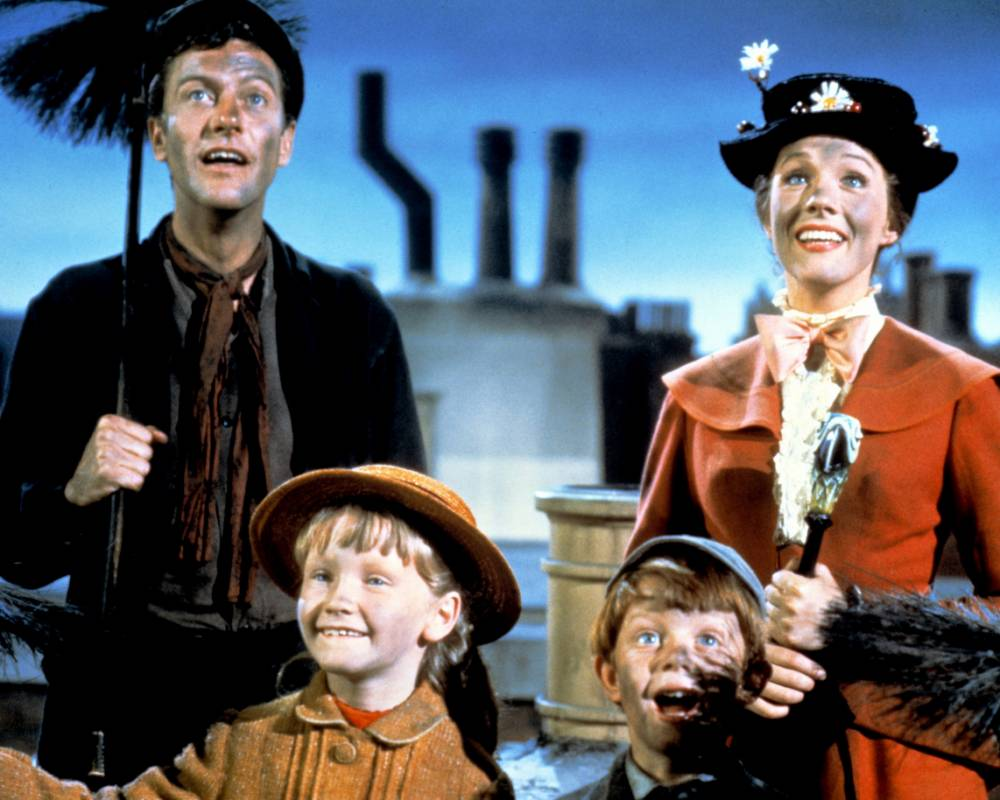 Film: Mary Poppins (1964), starring Dick Van Dyke as Bert, Julie Andrews as Mary Poppins, Karen Dotrice as Jane Banks and Matthew Garber as Michael Banks. Dick Van Dyke as Bert, Julie Andrews as Mary Poppins, Karen Dotrice as Jane Banks and Matthew Garber (1956 - 1977) as Michael Banks in the Disney musical 'Mary Poppins', directed by Robert Stevenson, 1964. (Photo by Silver Screen Collection/Hulton Archive/Getty Images)