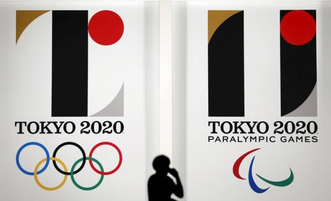Tokyo 2020 Olympic (L) and Paralympic Games emblems are displayed at Tokyo Metropolitan Government Building in Tokyo, in this July 24, 2015 file photo. Organisers for the Tokyo 2020 Olympics were poised to withdraw the official logo announced for the games just a month ago after its designer Kenjiro Sano admitted to copying presentation materials from the internet, media reports said on September 1, 2015. REUTERS/Issei Kato/Files