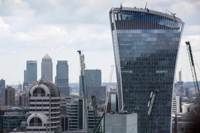 "A view of skyscrapers at the Canary Wharf business, financial and shopping district and 20 Fenchurch Street, also known as the ""Walkie-Talkie"", right, are seen on the skyline in London, U.K., on Monday, June 8, 2015. Job vacancies at Londons financial services companies jumped 52 percent last month with banks seeking more fixed-income traders as volatility in markets increased, according to a recruitment firm. Photographer: Jason Alden/Bloomberg via Getty Images"