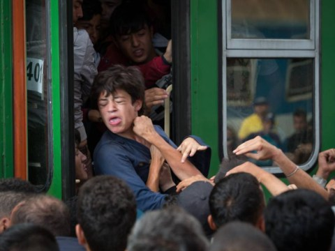 Young refugees forced to fight off other migrants for place on train