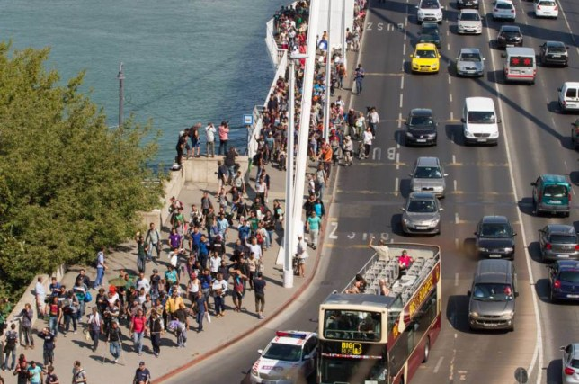 Mandatory Credit: Photo by PuzzlePix/REX Shutterstock (5041684m) Thousands of refugees started walking from Budapest railway station to Germany Refugees walk from Budapest Keleti railway station to the Austrian border, Hungary - 04 Sep 2015