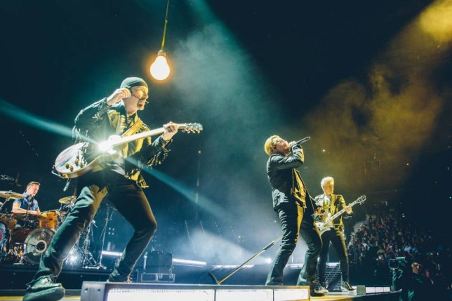 """Handout photo of (left to right) Larry Mullen Jr, The Edge, Bono and Adam Clayton on stage during the U2 concert at Turin's Pala Alpitour Arena as the band kicks off their European leg of their Innocence and Experience tour. PRESS ASSOCIATION Photo. Issue date: Saturday September 5, 2015. Bono drew attention to the plight of refugees during the concert. The frontman and activist said he did not have the answers to the refugee crisis but added that we """"must work together"""" to find the solution. See PA story SHOWBIZ U2. Photo credit should read: Danny North/U2/PA Wire NOTE TO EDITORS: This handout photo may only be used in for editorial reporting purposes for the contemporaneous illustration of events, things or the people in the image or facts mentioned in the caption. Reuse of the picture may require further permission from the copyright holder."""