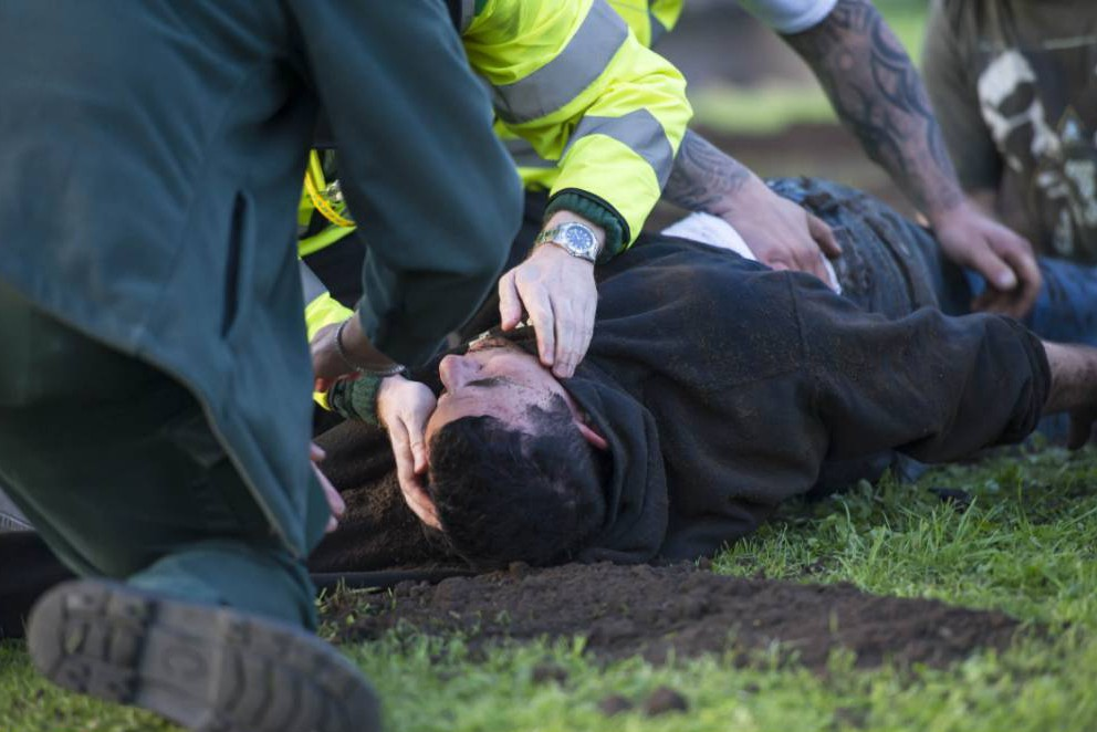 "A paramedic checks Antony Britton after he is pulled unconscious from the ""grave"" in his failed Buried Alive escape act Picture Paul Saripo Pic from MEN Syndication Mitchell Henry House Hollinwood Avenue Chadderton Oldham OL9 8EF syndication@men-news.co.uk"
