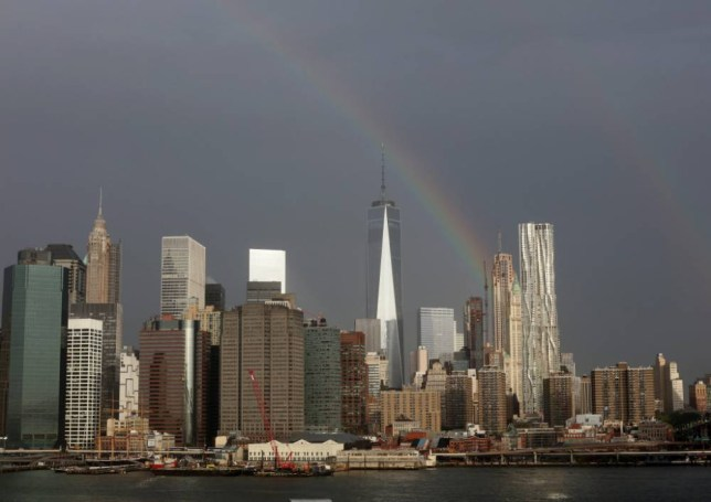 epa04923908 A rainbow over the One world trade center (Freedom Tower) and lower Manhattan in New York, New York, USA, 10 September 2015. EPA/ANDREW GOMBERT