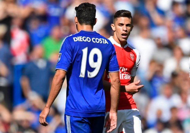 """Football - Chelsea v Arsenal - Barclays Premier League - Stamford Bridge - 19/9/15 Arsenal's Gabriel Paulista walks past Chelsea's Diego Costa after clashing Reuters / Dylan Martinez Livepic EDITORIAL USE ONLY. No use with unauthorized audio, video, data, fixture lists, club/league logos or """"live"""" services. Online in-match use limited to 45 images, no video emulation. No use in betting, games or single club/league/player publications. Please contact your account representative for further details."""