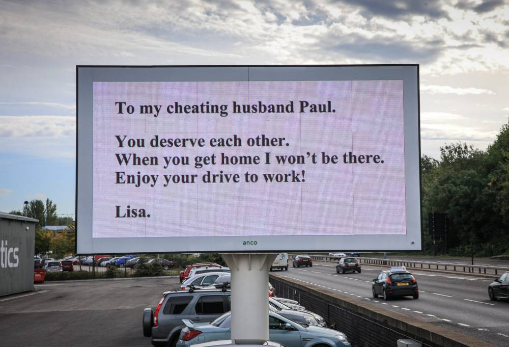 A sign appears on a Sheffield advertisement board this morning. Commuters were amused after a huge sign on The Parkway, the main road into Sheffield appears to out cheating husband Paul. See rossparry copy RPYSIGN
