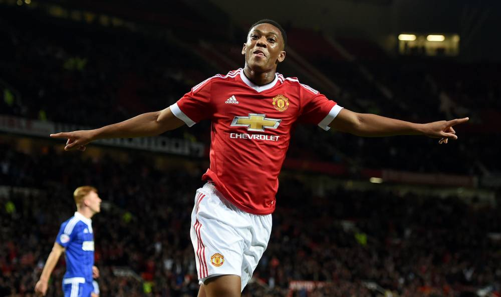 """Manchester United's Anthony Martial celebrates scoring his team's third goal of the game during the Capital One Cup, third round match at Old Trafford, Manchester. PRESS ASSOCIATION Photo. Picture date: Wednesday September 23, 2015. See PA story SOCCER Man Utd. Photo credit should read: Martin Rickett/PA Wire. RESTRICTIONS: EDITORIAL USE ONLY No use with unauthorised audio, video, data, fixture lists, club/league logos or """"live"""" services. Online in-match use limited to 45 images, no video emulation. No use in betting, games or single club/league/player publications."""