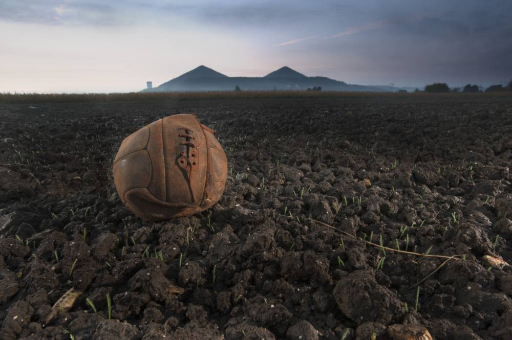 PIC FROM MICHAEL ST. MAUR SHELL/MARY EVANS PICTURE LIBRARY/ CATERS NEWS - (PICTURED: London Irish Rifles - The Loos Football This is the football wich the LIR kicked across No Mans Land on Sept 25th 1915 as they attacked the German positions in the town of Loos.) - Exactly a century after The Battle of Loos, these poignant images reveal the battlefield as it looks today and the football British soldiers bravely dribbled towards the German frontline in a show of courage. Photographer, Michael St. Maur Sheil took the extraordinary shots as part of a body of work called Fields of Battle-Lands of Peace 14-18. SEE CATERS COPY