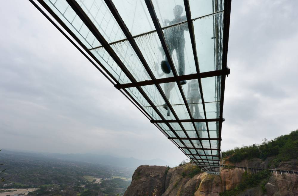 Who fancies a stroll over this GLASS suspension bridge 600 feet above a canyon?