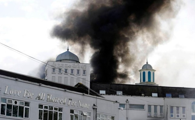 The scene at a fire at the Baitul Futuh Mosque in Morden, south London. PRESS ASSOCIATION Photo. Picture date: Saturday September 26, 2015. See PA story FIRE Mosque. Photo credit should read: Lauren Hurley/PA Wire