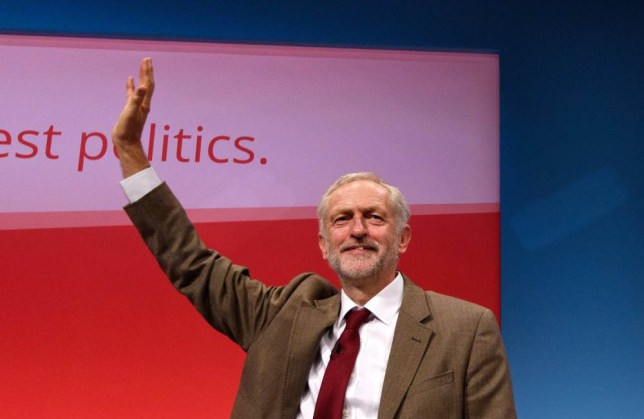 BRIGHTON, ENGLAND - SEPTEMBER 29: Labour Leader Jeremy Corbyn waves to delegates after his first leadership speech on September 29, 2015 in Brighton, England. The four day annual Labour Party Conference takes place in Brighton and is expected to attract thousands of delegates with keynote speeches from influential politicians and over 500 fringe events. (Photo by Ben Pruchnie/Getty Images)