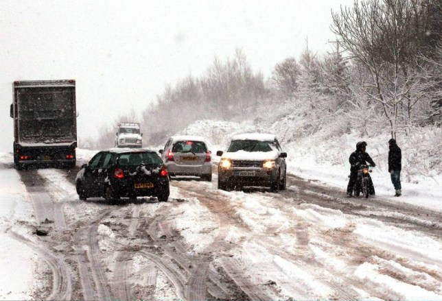 BATH, UNITED KINGDOM - JANUARY 18: Vehicles struggle in the snow on the normally busy A367 between Bath and Peasedown St John on January 18, 2013 near Bath, England. Heavy snow is bringing widespread disruption to many parts of the UK. (Photo by Matt Cardy/Getty Images)