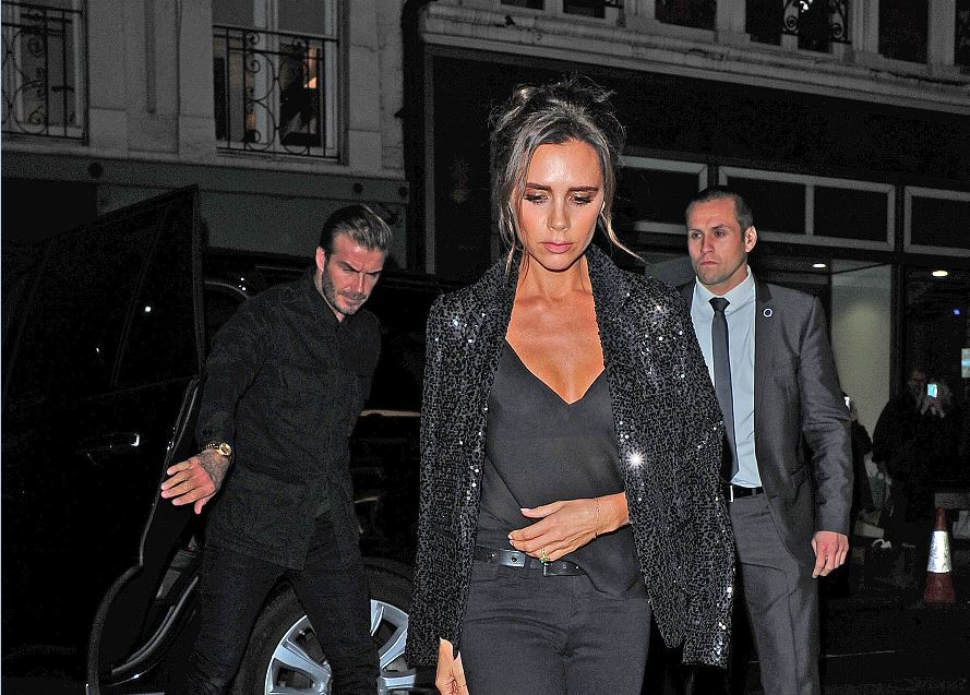 Victoria Beckham arrived at her LFW party in style, but left a little wet (Picture: Xposure)