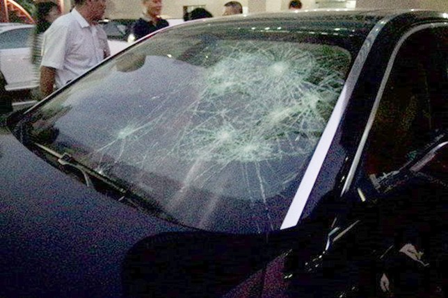 Pic shows: Car damage.nnA crowd of shocked onlookers could only watch on as an angry woman smashed her husband¿s BMW after finding out that he had been seeing another woman behind her back.nnThe unnamed woman first caught the attention of citizens in Shenzhen, a major city in China¿s southern Guangdong Province, when locals heard banging sounds coming from a roadside parking lot.nnLocal residents and shopkeepers were then surprised to find a middle-aged woman with short hair angrily and relentlessly hitting a black BMW with a hammer.nnShe smashed the car windows, dented the doors, broke the rear view mirror, and even removed the BMW sign with the tool.nnAmateur footage of the incident shows the woman continuously hitting the BMW, despite hurting her hand with shards of broken glass during the 30-minute attack.nnThe parking lot security guard eventually mustered up the courage to ask the woman to stop, at which point she angrily told him to mind his own business as the car was hers and she could do with it what she wanted.nnShe finally revealed the reason behind her attacking her own car when she said she recently found that her husband had been cheating on her, and that, unable to hit her husband with a hammer, she could only take out her anger on husband¿s car ¿ which was registered under her name anyway.nn(ends)